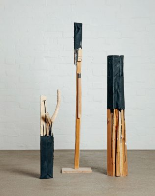 Nao Matsunaga Forlorn Tree 1,2,3 Wood, canvas, bitumen paint (2011)